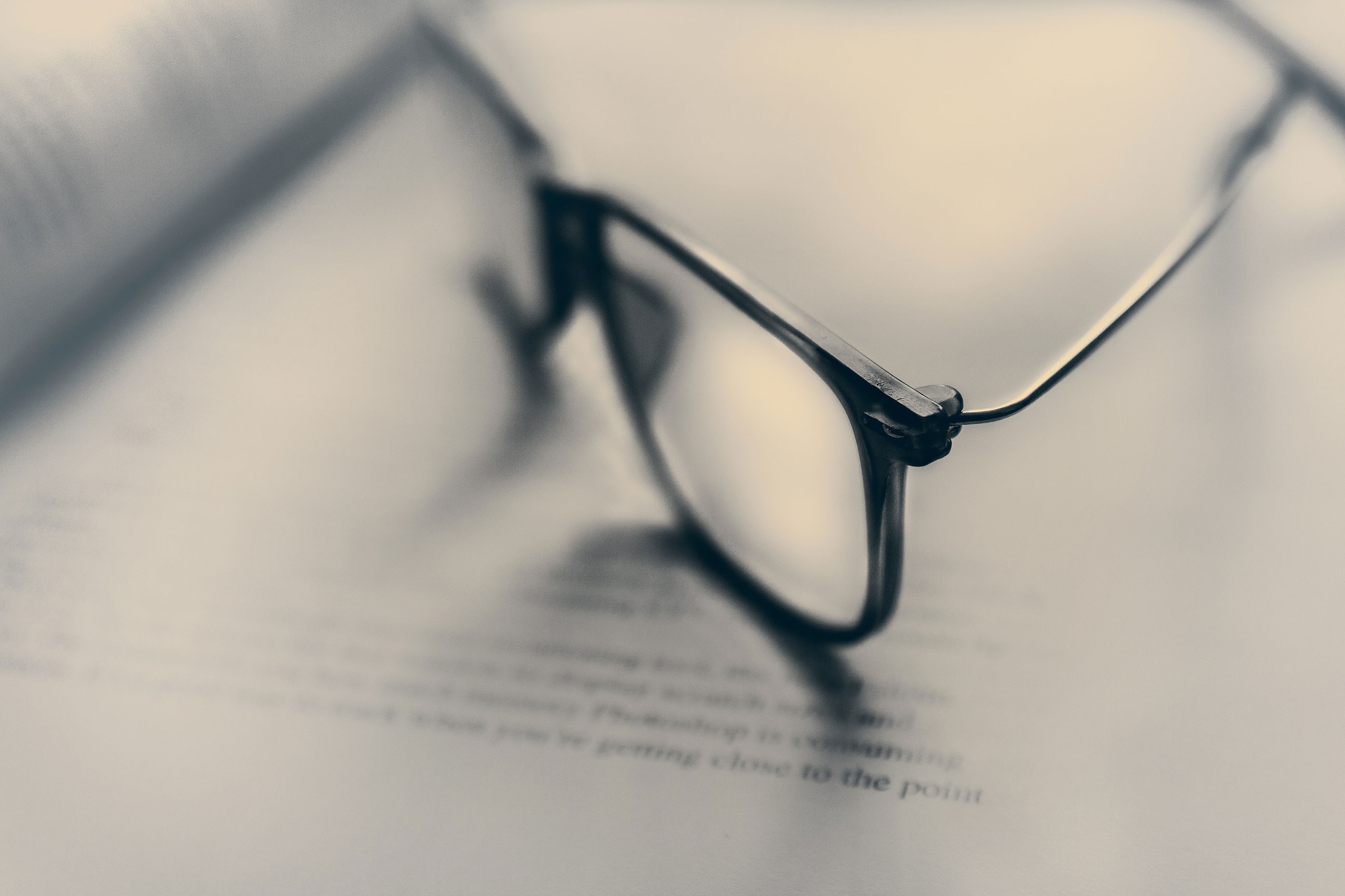 Glasses on book